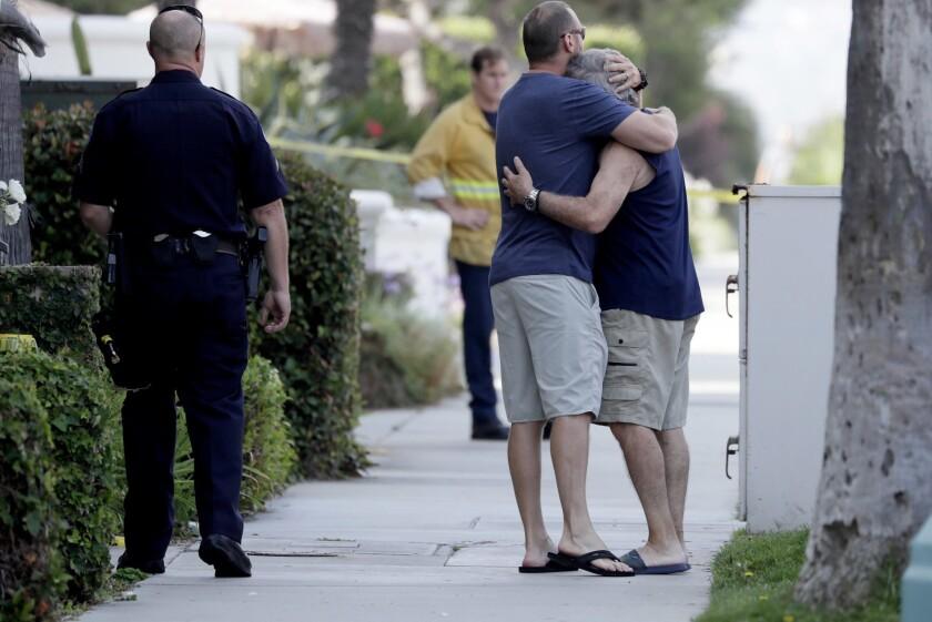 REDONDO BEACH, CA JULY 12, 2018 -- Family members console one another outside a Redondo Beach condo