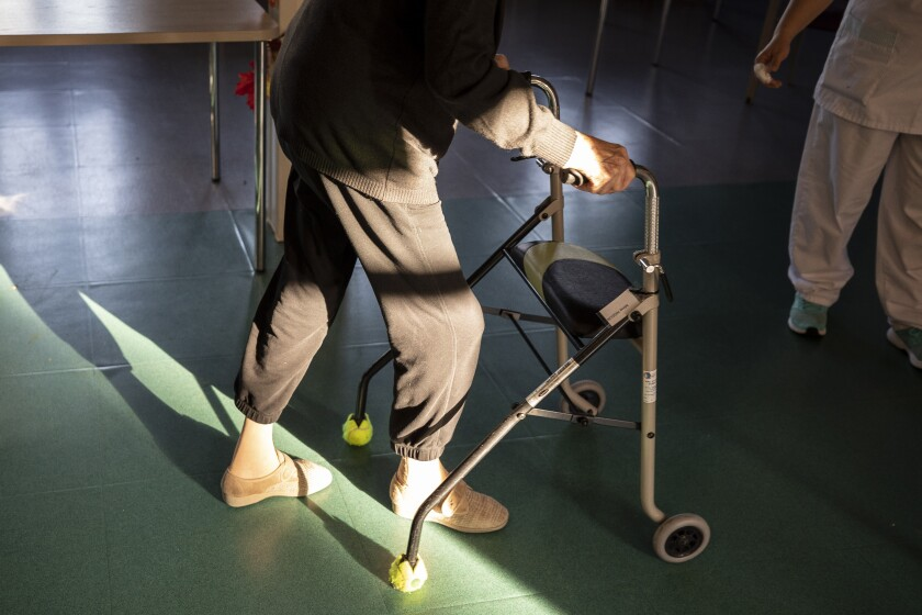 A man leaves after being tested with a PCR COVID-19 test in a nursing home of Ammerschwihr, eastern France, Monday, Nov. 9, 2020. The aid group Doctors Without Borders has issued an appeal Wednesday Nov. 11, 2020, for medics, psychologists and other volunteers to work in Paris region nursing homes, where they say more people with the coronavirus have died so far in November than reported in the previous five months combined. (AP Photo/Jean-Francois Badias)