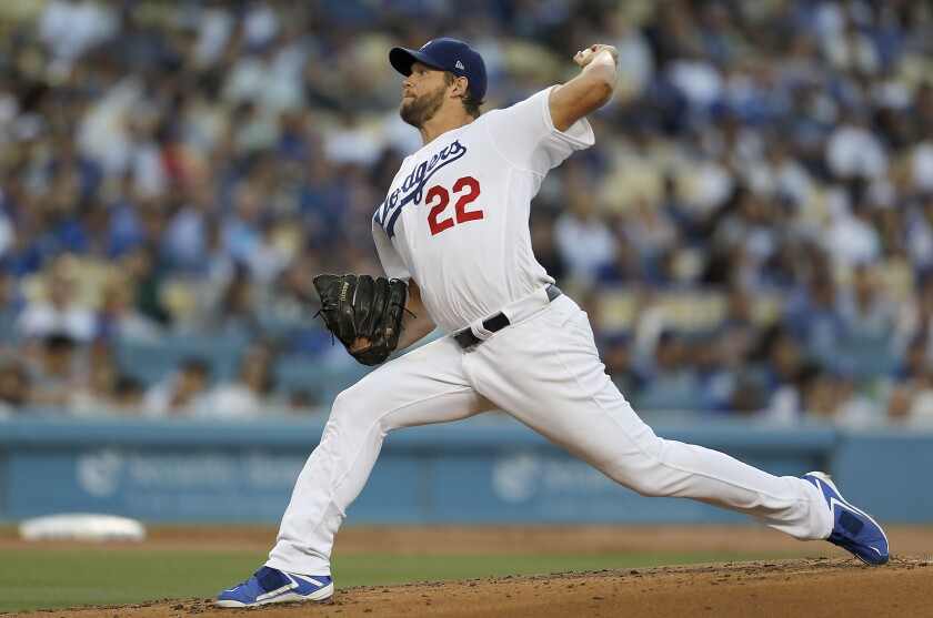Dodgers pitcher Clayton Kershaw delivers a pitch against the San Diego Padres in the second inning on Thursday at Dodger Stadium.