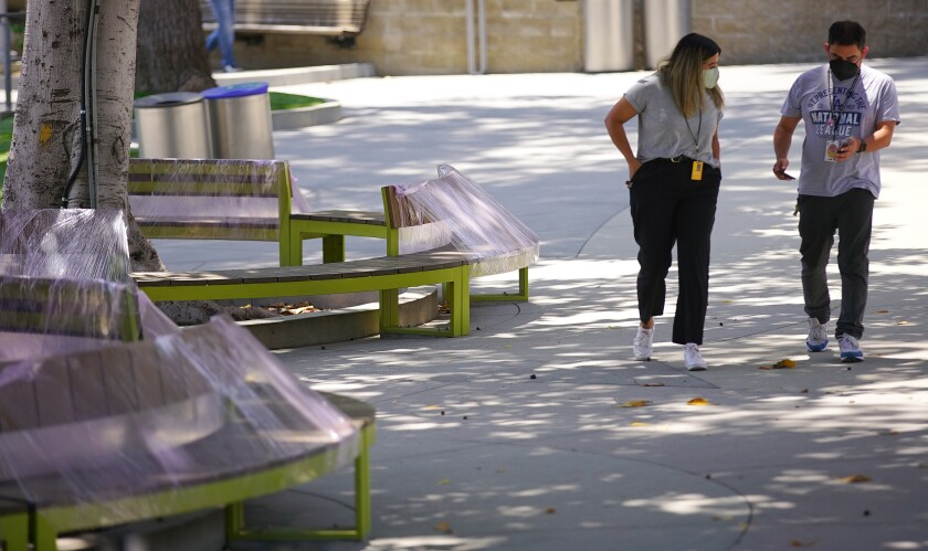 Plastic-wrapped bench seats in a public area of the Hollywood Bowl.
