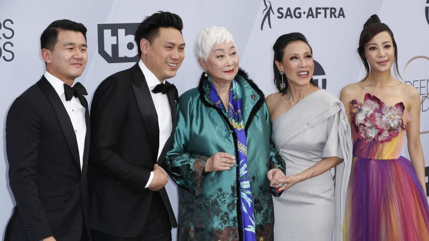 """LOS ANGELES, CA - January 27, 2019- Cast members from """"Crazy Rich Asians"""" arriving at the 25th Scree"""