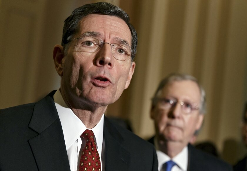 Sen. John Barrasso, R-Wyo., the Republican Policy Committee chairman, joins Senate Minority Leader Mitch McConnell, R-Ky., right, in criticizing Senate Democrats following a procedural vote on legislation to renew jobless benefits for the long-term unemployed, at the Capitol in Washington, Tuesday, Jan. 07, 2014. Sen. McConnell said that Senate Majority Leader Harry Reid, D-Nev., is almost entirely responsible for making the Senate dysfunctional. (AP Photo/J. Scott Applewhite)