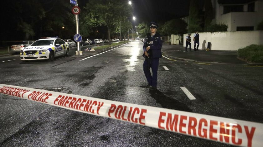 A police officer patrols at a cordon near a mosque in central Christchurch, New Zealand, on Friday.