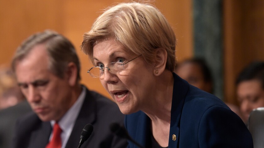 Sen. Elizabeth Warren, shown Sept. 20, is asking the U.S. Education Department to halt all collections on Corinthian College students' debt and discharge their federal loans.
