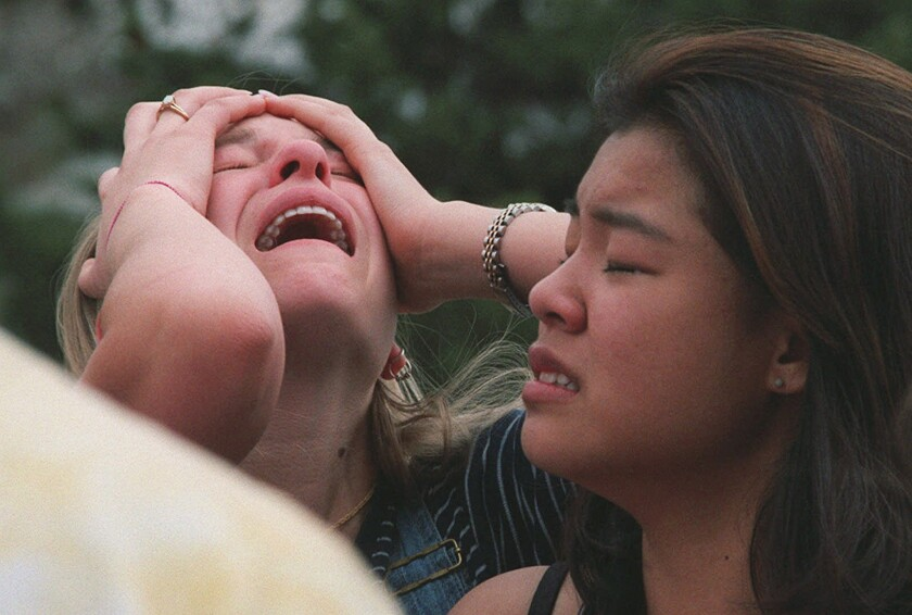 Columbine High School students react at a triage site near the school in Littleton, Colo., after the shooting April 20, 1999.