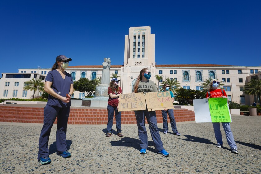 A small group of medical professionals demonstrated in front of the San Diego County Administration building on the Embarcadero in downtown San Diego on Saturday. They wanted to remind people to not become complacent with the novel coronavirus pandemic.