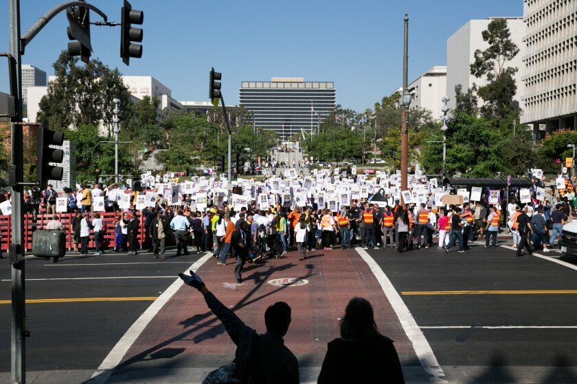 The L.A. City Council approved a wide-ranging salary agreement with with the Coalition of L.A. City Unions on Tuesday. Pictured above, the group protests in downtown Los Angeles in October 2014.