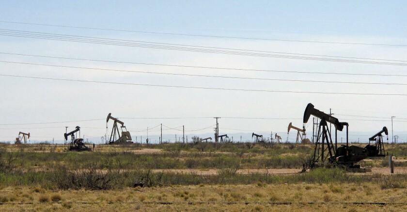 Oil rigs stand in the Loco Hills field near Artesia, N.M.