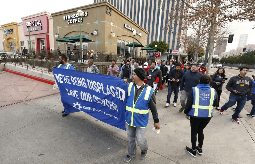 Demonstrators rally in support of the Central American Resource Center, or CARECEN.