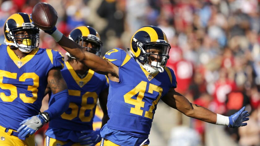 Rams cornerback Kevin Peterson celebrates after intercepting a pass during a game against the San Francisco 49ers in 2017. Peterson is battling for a roster spot in the Rams' secondary.