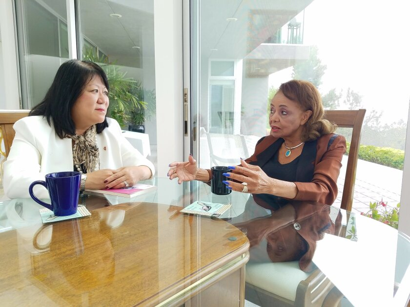 Ellen Junn, president of California State University-Stanislaus, visits with her storied predecessor Marvalene Hughes in her Del Mar home last month.