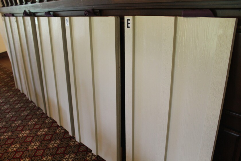 The RSF Association board considered samples of imitation wood and wood planks.