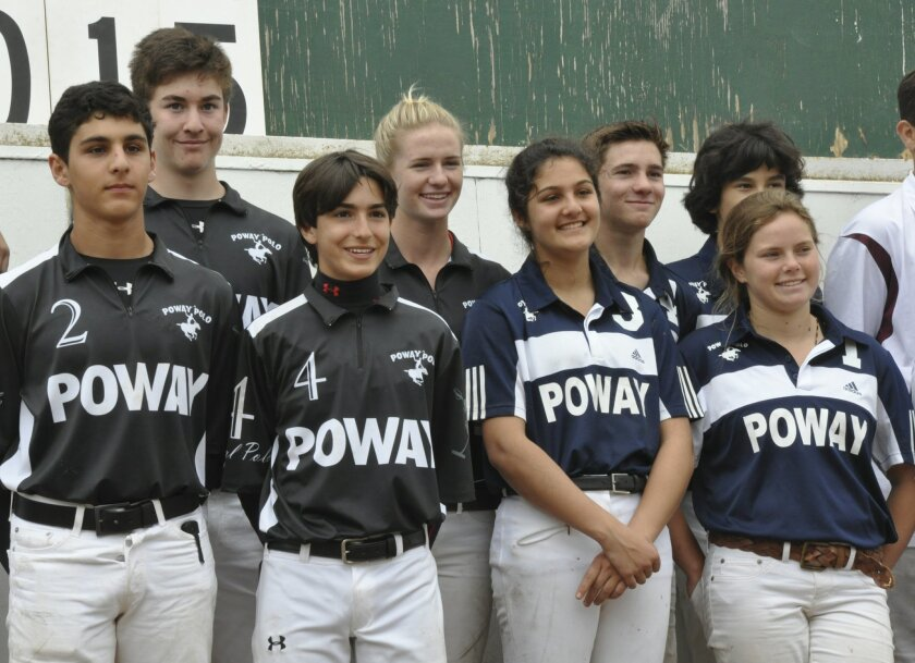 The Poway varsity team, in black, stands with the Poway junior varsity team, in blue, at the regional championships.