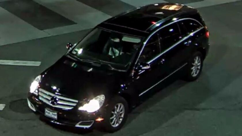 An image of the Mercedes-Benz, believed to be an R-Class SUV, suspected of damaging storefronts in B