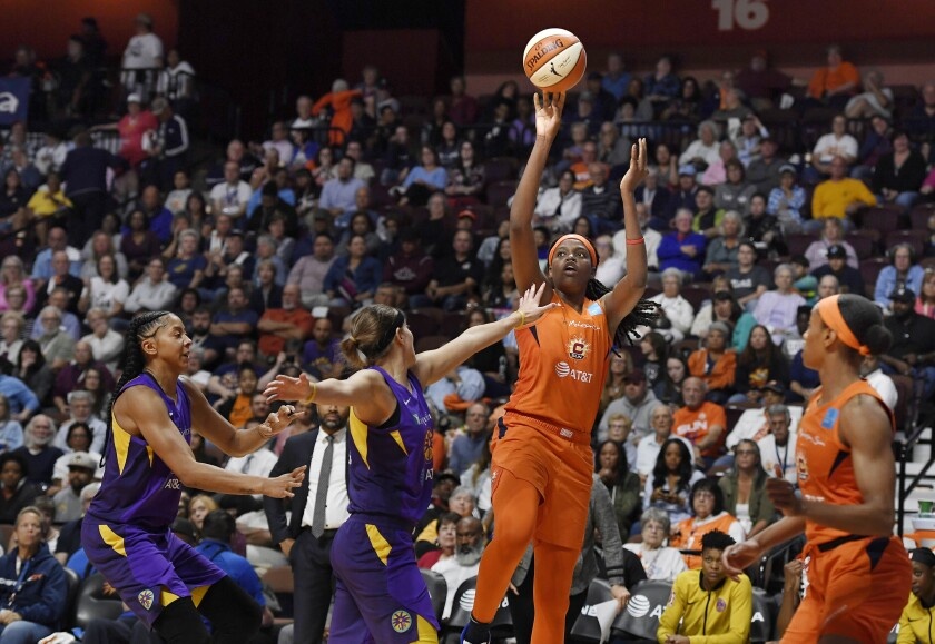 Connecticut Sun's Jonquel Jones shoots over Los Angeles Sparks' Sydney Wiese during the second half of Game 2 of a WNBA basketball playoff game Thursday, Sept. 19, 2019, in Uncasville, Conn. (AP Photo/Jessica Hill)