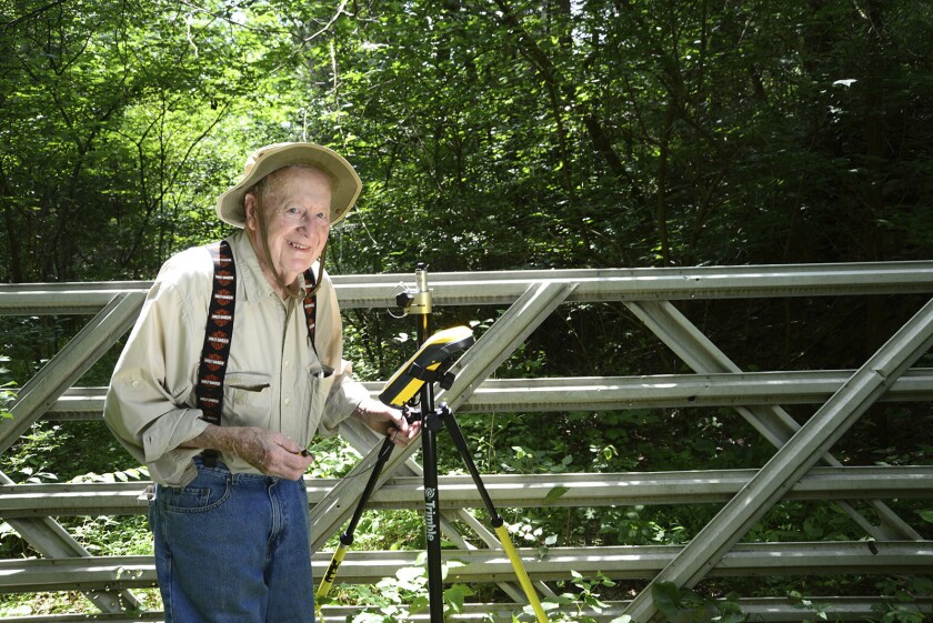 "This Aug. 2, 2016 photo provided by Indiana Department of Natural Resources shows Bob Vollmer. Vollmer, 102, who is Indiana's oldest state employee is retiring after nearly six decades on the job, saying that ""your body tells you when it's time to go."" Vollmer plans to report to work for the last time Feb. 6, 2020, as a surveyor for the Indiana Department of Natural Resources. The southern Indiana man, whose mother lived to be 108, joined the state agency in 1962. (John Maxwell/ Indiana Department of Natural Resources via AP)"