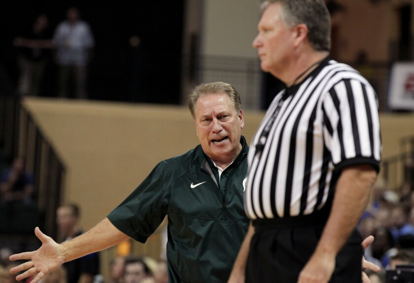 Michigan State Coach Tom Izzo, left, talks to referee Karl Hess during the second half of a game on Nov. 30.