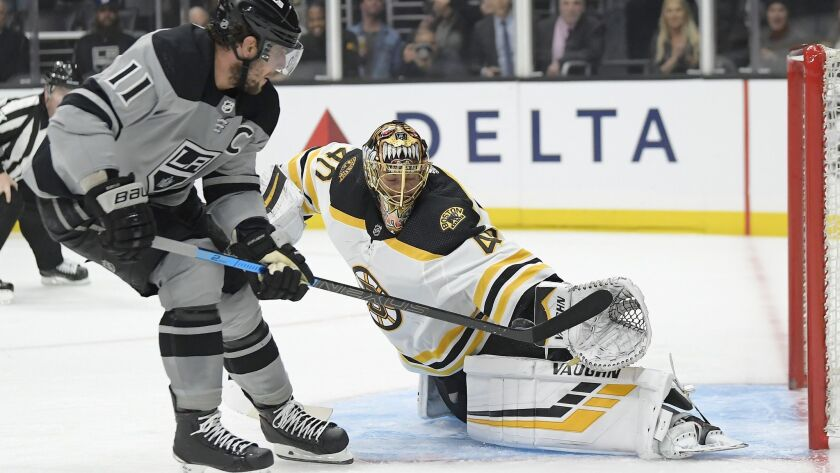 Boston Bruins goaltender Tuukka Rask, right, stops a shot by Kings center Anze Kopitar during the second period on Saturday.