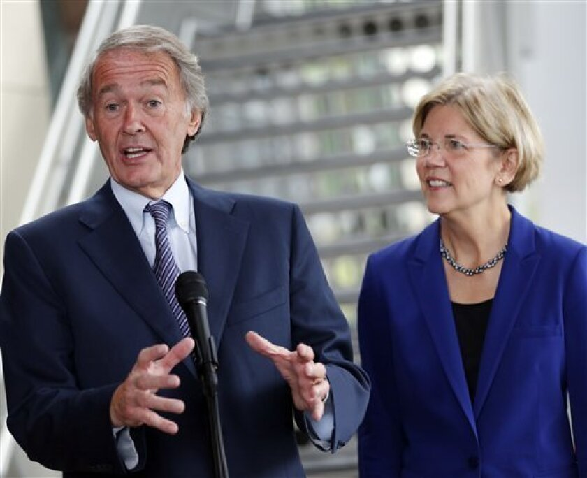 FILE - In this Oct. 3, 2012 file photo, Rep. Ed Markey, D-Mass., left, accompanied by then-Democratic Senate candidate Elizabeth Warren, gestures as he speaks with reporters as she campaigned in Medford, Mass.  Markey said Thursday, Dec. 27, 2012 that he plans to run for John Kerry's Senate seat if