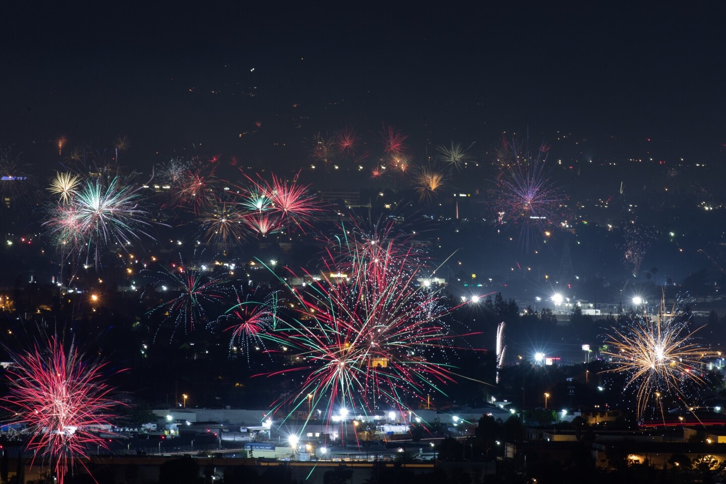 Fireworks over North Hollywood, as seen from the Burbank Hills on July Fourth.