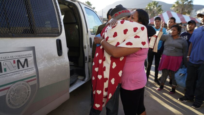 Just outside the new shelter at El Barretal in east Tijuana, family and friends say their farewells to those who have decide to voluntarily repatriated back to their home country.