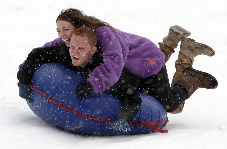 Jonah Lavin, 19, and girlfriend Sascha Spiegel 18, enjoy sledding at Big Bear Snow Play.