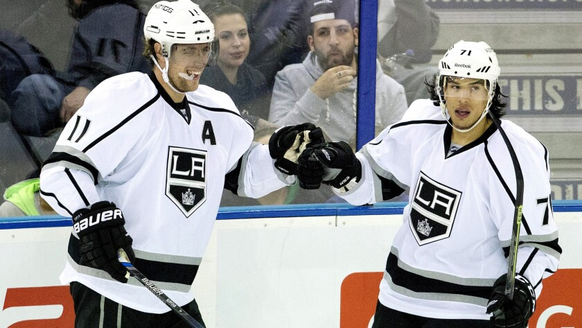 Kings center Anze Kopitar (11) celebrates with teammate Jordan Nolan after scoring against the Oilers in the second period Sunday.