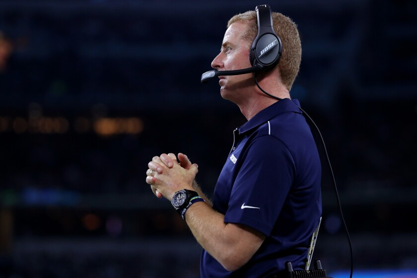 Cowboys coach Jason Garrett looks on during the fourth quarter of a game against the Redskins at AT&T Stadium on Dec. 29.