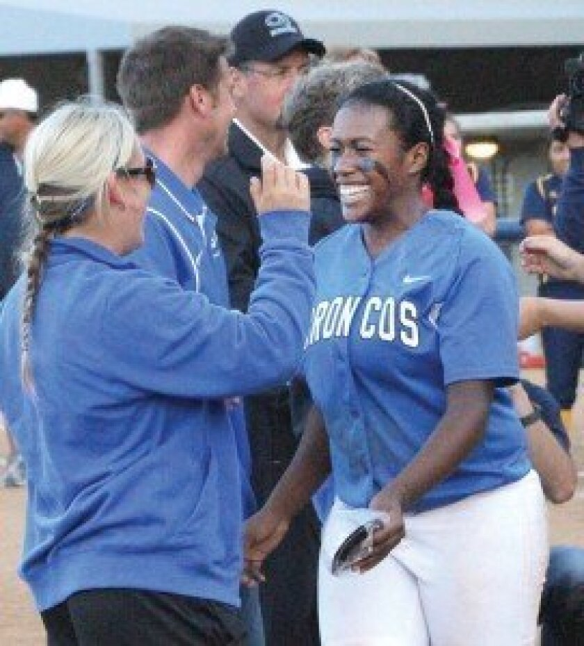 RB coach Summer Boyle, left, and Tiana Miller, right, celebrate after the Broncos captured the CIF San Diego Section Division II crown. Photo by Jon Dickstein.