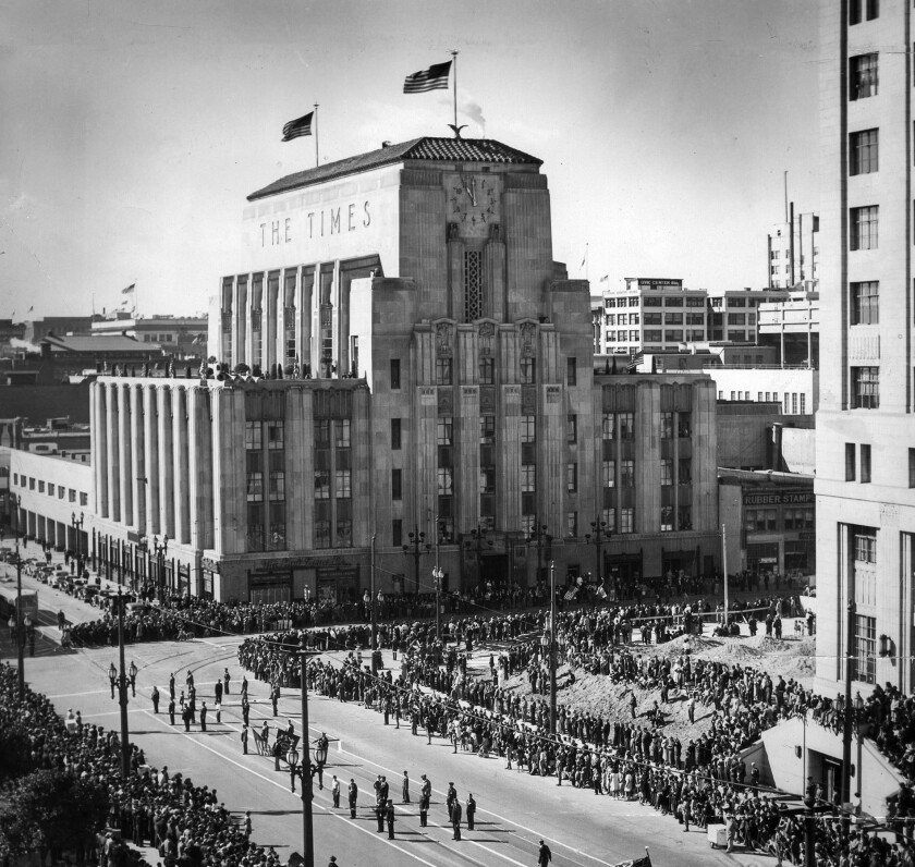 Nov. 11, 1938: Armistice Day parade with the Los Angeles Times building in background. View is looking south on Spring Street at First Street from Los Angeles City Hall.