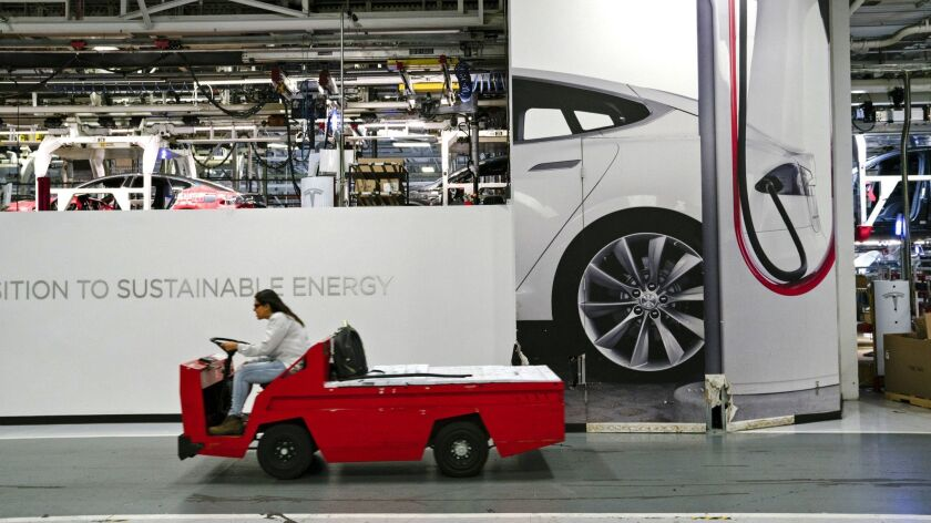 Inside Tesla's Fremont, Calif., automobile plant, which has been ramping up production of the new Model 3 sedan.