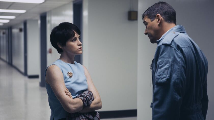 "(L-R) - CLAIRE FOY as Janet Armstrong and KYLE CHANDLER as Deke Slayton in ""First Man,"" directed by"