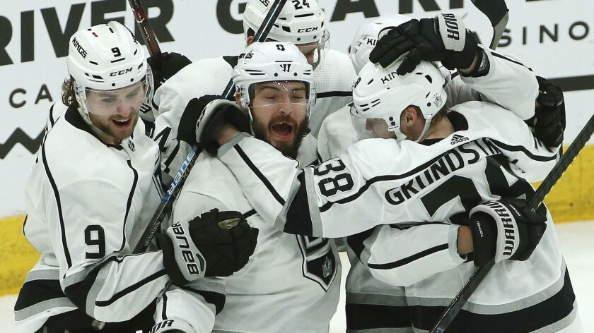 Los Angeles Kings forward Carl Grundstrom (38) celebrates with teammates after scoring against the Arizona Coyotes on Saturday.