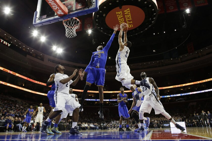 Delaware's Barnett Harris (2) and Villanova's Josh Hart (3) leap for a rebound during the first half of an NCAA college basketball game, Sunday, Nov. 30, 2014, in Philadelphia. (AP Photo/Matt Slocum)
