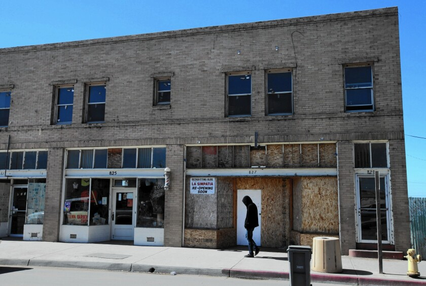 Many vacant buildings lined the main street of Guadalupe in October 2010.