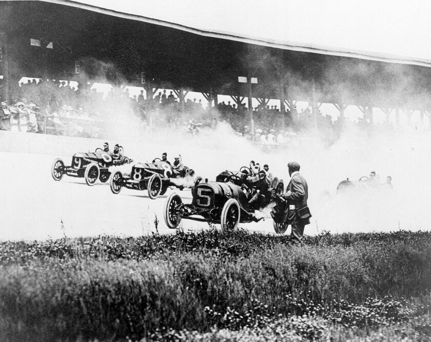 FILE - In this May 30, 2011, file photo, drivers Will Jones (9), Joe Jagersberger (8) and Louis Disbrow (5) race with their riding mechanics in the first Indianapolis 500 auto race at Indianapolis Motor Speedway in Indianapolis, Ind. (AP Photo/File)