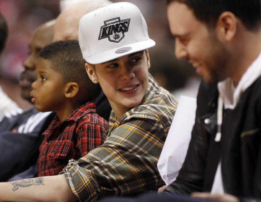 Justin Bieber at a Clippers-Celtics game. Bieber allegedly spat on a neighbor, according to a battery complaint.