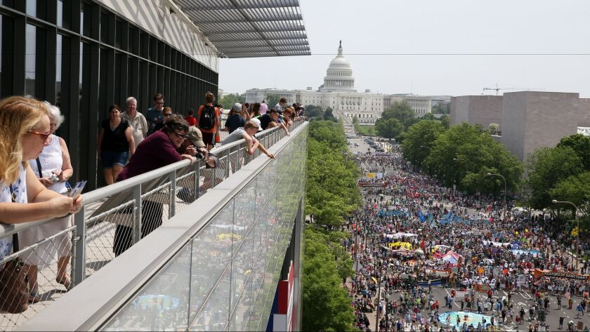 Protesters make their way from the Capitol to the White House on Saturday for the Peoples Climate March, held on President Trump's 100th day in office.