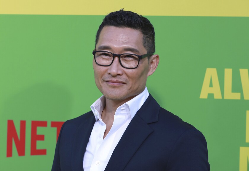 Daniel Dae Kim posing in glasses and a navy suit