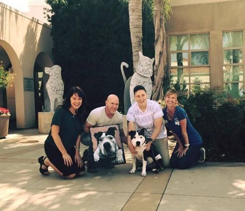 L-R: Liz Grumet (Art for Barks Board Member), Stephen Fishwick (artist), Elizabeth Graham (Beanie's mom) and Elkie Wills (SD Humane Society, Director of Community Engagement). Courtesy photo