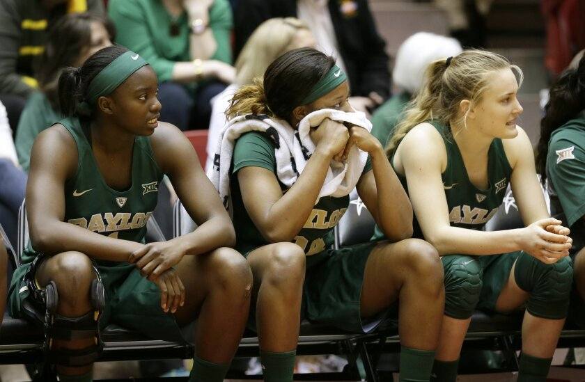 Baylor players sit on the bench during the second half of an NCAA college basketball game against Iowa State, Saturday, Feb. 28, 2015, in Ames, Iowa. Iowa State won 76-71. (AP Photo/Charlie Neibergall)