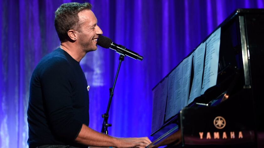 Coldplay's Chris Martin performs songs by George Michael, Leonard Cohen, Prince and David Bowie during An Unforgettable Evening.