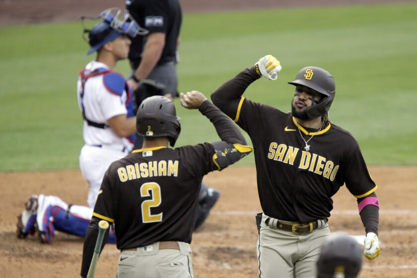 Fernando Tatis Jr. of the Padres celebrates his home run with Trent Grisham against the Dodgers.
