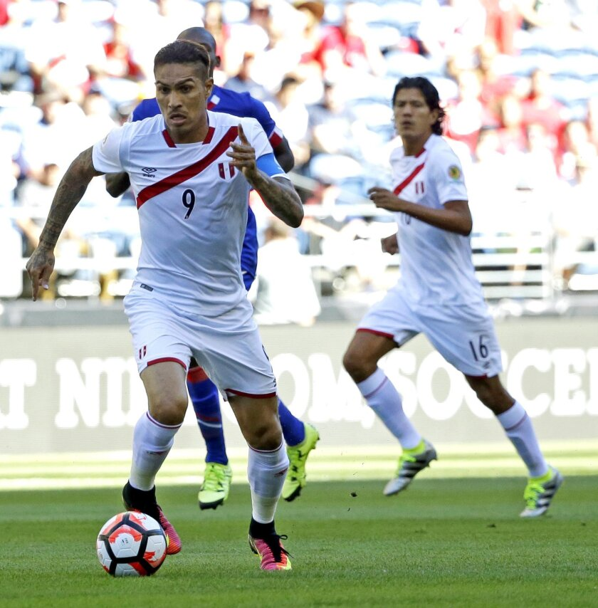 Peru forward Paolo Guerrero (9) drives the ball against Haiti in the first half of a Copa America Centenario soccer match, Saturday, June 4, 2016, in at CenturyLink Field in Seattle. (AP Photo/Ted S. Warren)