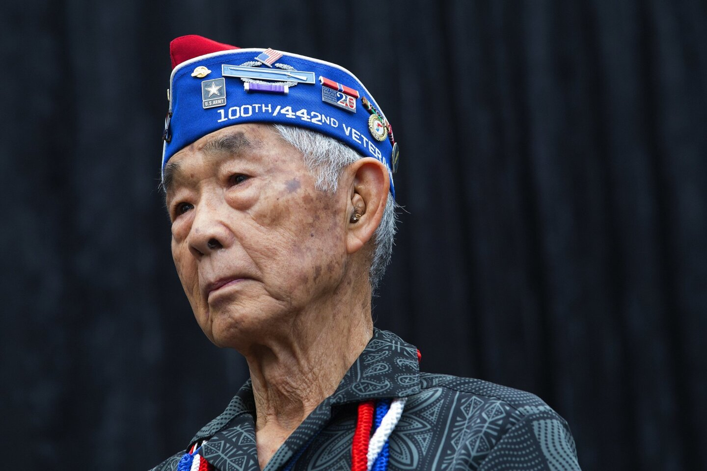 Former U.S. Army Staff Sgt. Frank M. Wada stood center stage as his bio was read out load to those in attendance to witness 14 World War II veterans receive the French Legion of Honor medal.