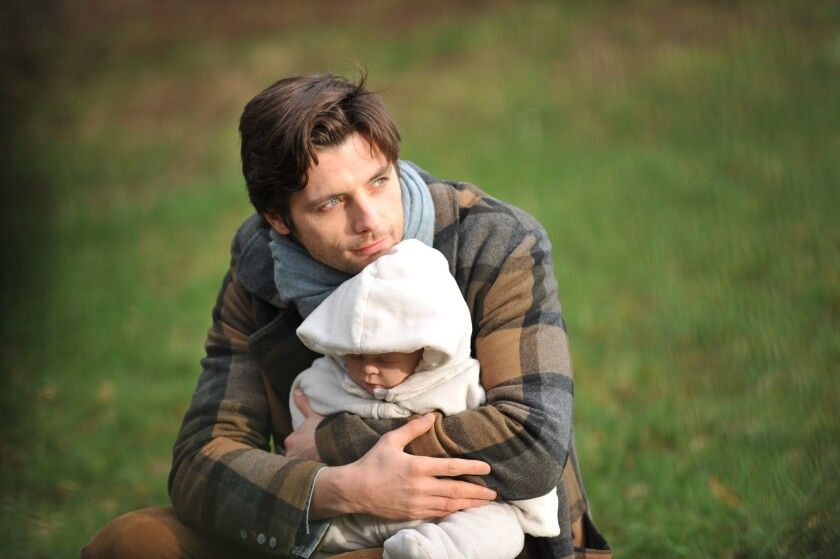 """Raphaël Personnaz and Baby Léo in Clément Michel's """"The Stroller Strategy."""""""