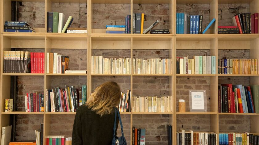 LOS ANGELES, CA. -- FEBRUARY 10, 2017: Blue Bottle's bookshelves are stocked with books for sale wit
