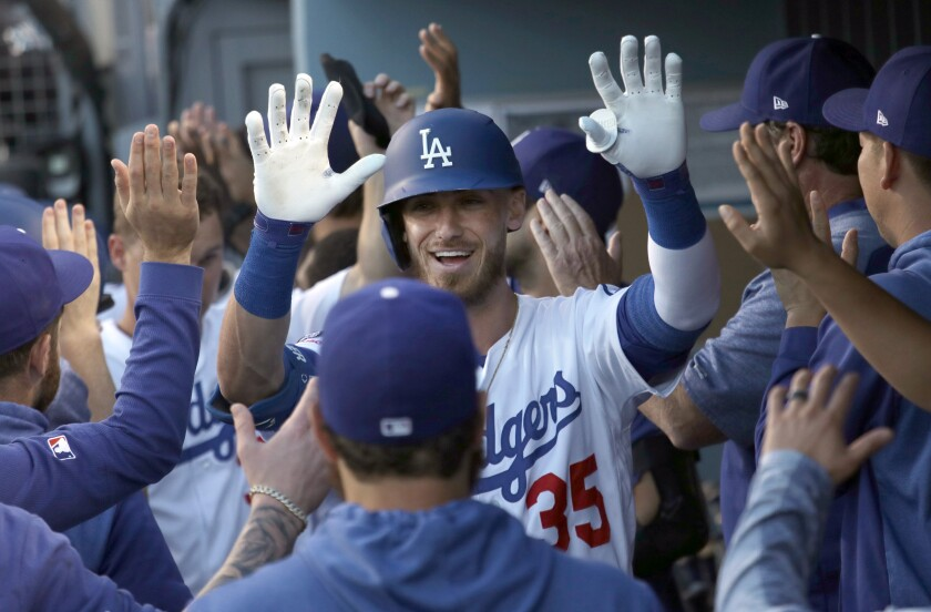 Cody Bellinger celebrates with his Dodgers teammates.