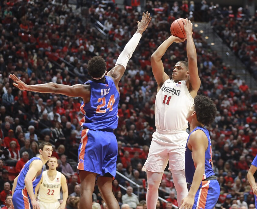 Aztecs' Matt Mitchell shoots over Abu Kigab of Boise State in January.