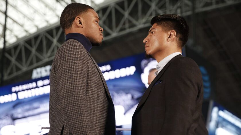 Errol Spence Jr., left, and Mikey Garcia stare down one another during a Feb. 19 promotional event at AT&T Stadium in Arlington, Texas.